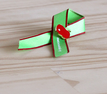 Apple Logo:::Bowel Cancer Awareness Ribbon